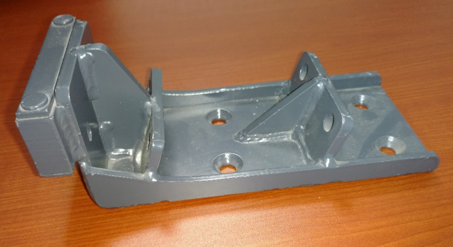 Trough Mounting Bracket shown as a mild carbon steel weldment, machined and painted.